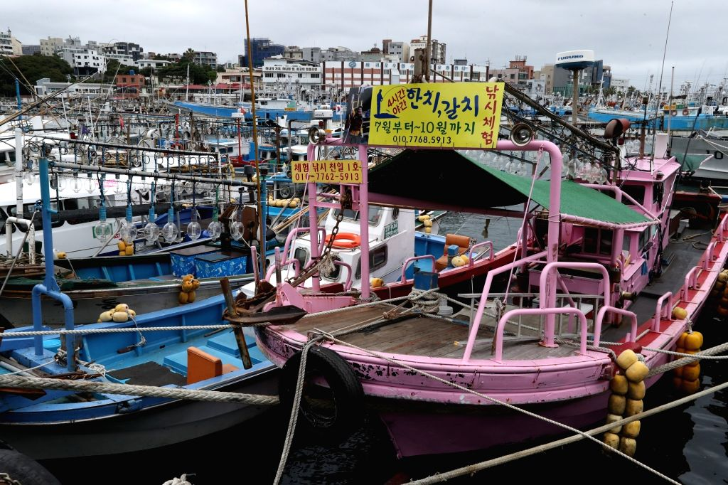 Ships dock in the Seogwipo port on the southern resort island of Jeju to avoid any damage from Typhoon Talim on Sept. 16, 2017, amid a typhoon advisory issued by the state weather agency for the ...