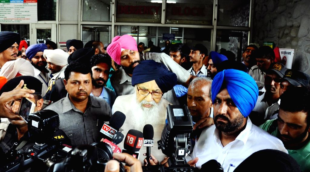 Shiromani Akali Dal leader Parkash Singh Badal talks to press after meeting AAP MLA Sarabjit Kaur Manuke who was admitted to hospital after she sustained injuries while being forcibly evicted from ... - Parkash Singh Badal and Sarabjit Kaur Manuke