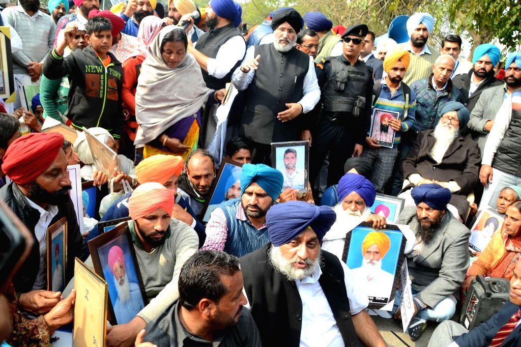 Shiromani Akali Dal leader Sukhbir Singh Badal participates in a demonstration with the families of farmers, who had committed suicide in the last two years, in Chandigarh on Feb 12, 2019. - Sukhbir Singh Badal