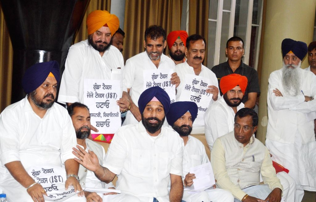 Shiromani Akali Dal (SAD) leader talks to the press after the party's demonstration at Punjab Assembly in Chandigarh, on March 28, 2018.