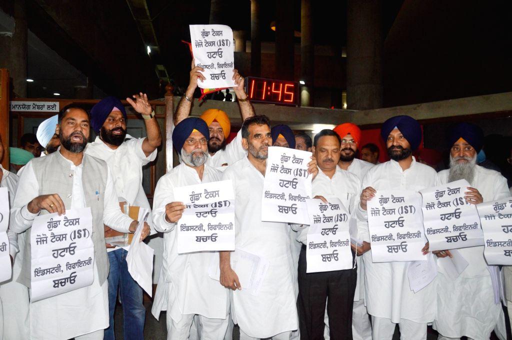 Shiromani Akali Dal (SAD) legislators led by Bikram Singh Majithia, stage a demonstration at Punjab Assembly in Chandigarh, on March 28, 2018. - Bikram Singh Majithia