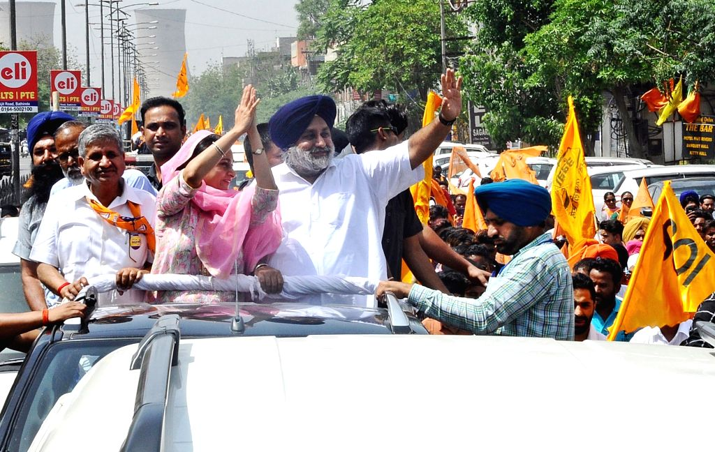 Shiromani Akali Dal (SAD) Lok Sabha candidate from Bathinda, Harsimrat Kaur Badal with her husband and SAD President Sukhbir Singh Badal during a roadshow, ahead of her filing of nomination ... - Harsimrat Kaur Badal and Sukhbir Singh Badal