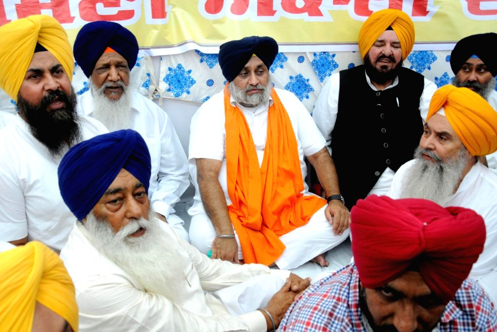 "Shiromani Akali Dal (SAD) president Sukhbir Singh Badal along with other SAD leaders stage a demonstration against the Congress government, for casting ""persistent, repeated and ... - Sukhbir Singh Badal"