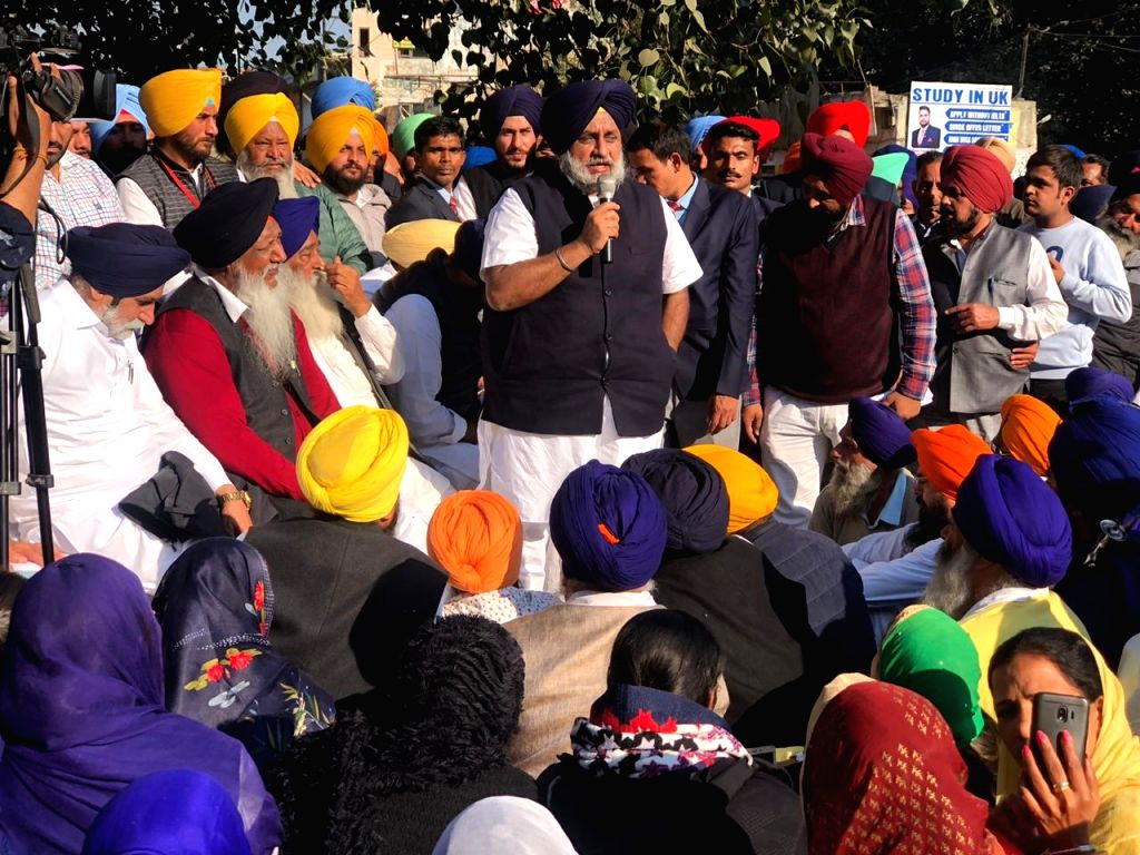 Shiromani Akali Dal (SAD) President Sukhbir Singh Badal addresses party workers during a demonstration against the murder of former Sarpanch and Akali leader Dalbir Singh Dhilwan, in ... - Sukhbir Singh Badal and Dalbir Singh Dhilwan