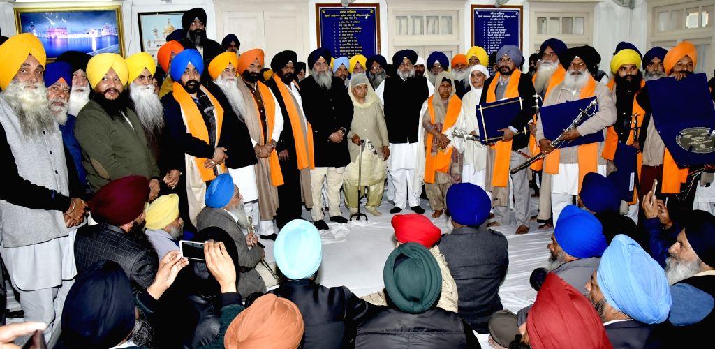 Shiromani Gurdwara Parbandhak Committee (SGPC) President Gobind Singh Longowal and Shiromani Akali Dal (SAD) President Sukhbir Singh Badal during a programme at Golden Temple in Amritsar, ... - Gobind Singh Longowal and Sukhbir Singh Badal