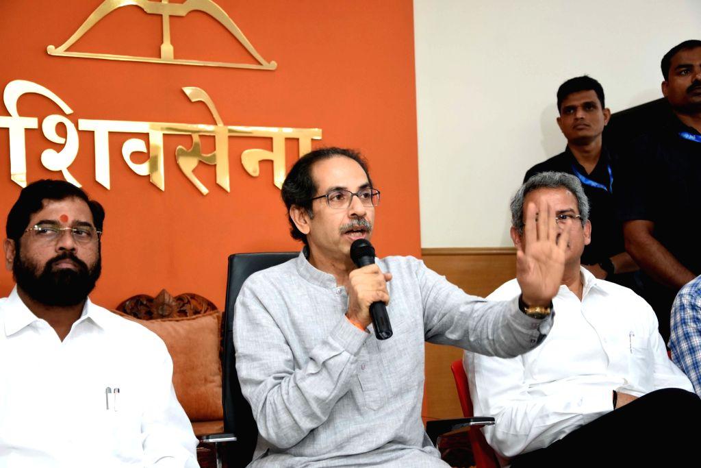 Shiv Sena chief Uddhav Thackeray and Eknath Shinde (L). (Photo: IANS)