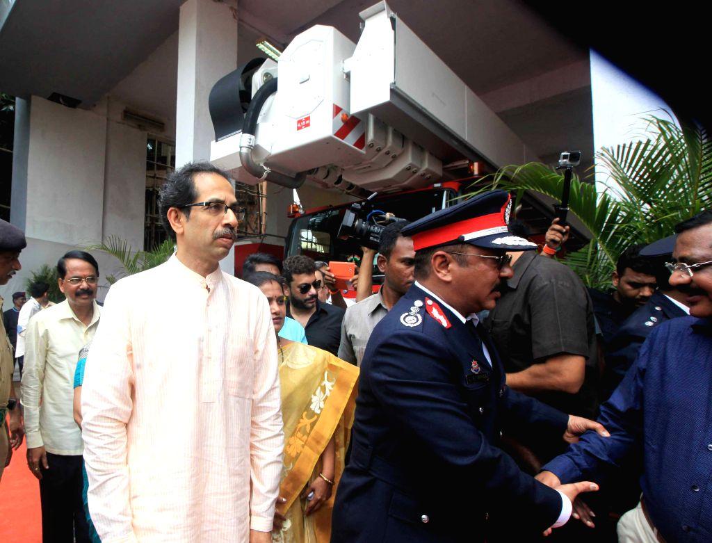 Shiv Sena chief Uddhav Thackeray at the inauguration of the Bronto Skylift - 90 metre hydraulic platform of the Mumbai Fire Brigade in Mumbai, on Aug 16, 2015.