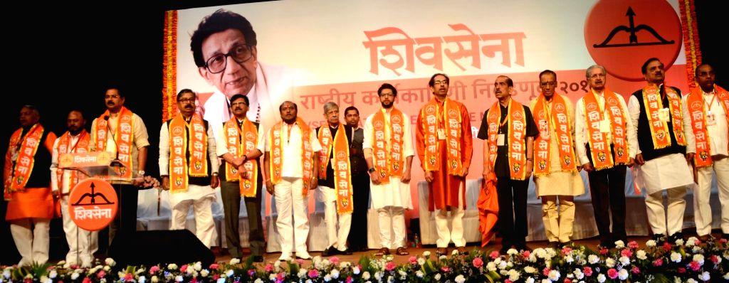 Shiv Sena chief Uddhav Thackeray, his son Aditya Thackeray and other party leaders during National Executive meeting in Worli, Mumbai on Jan 23, 2018.