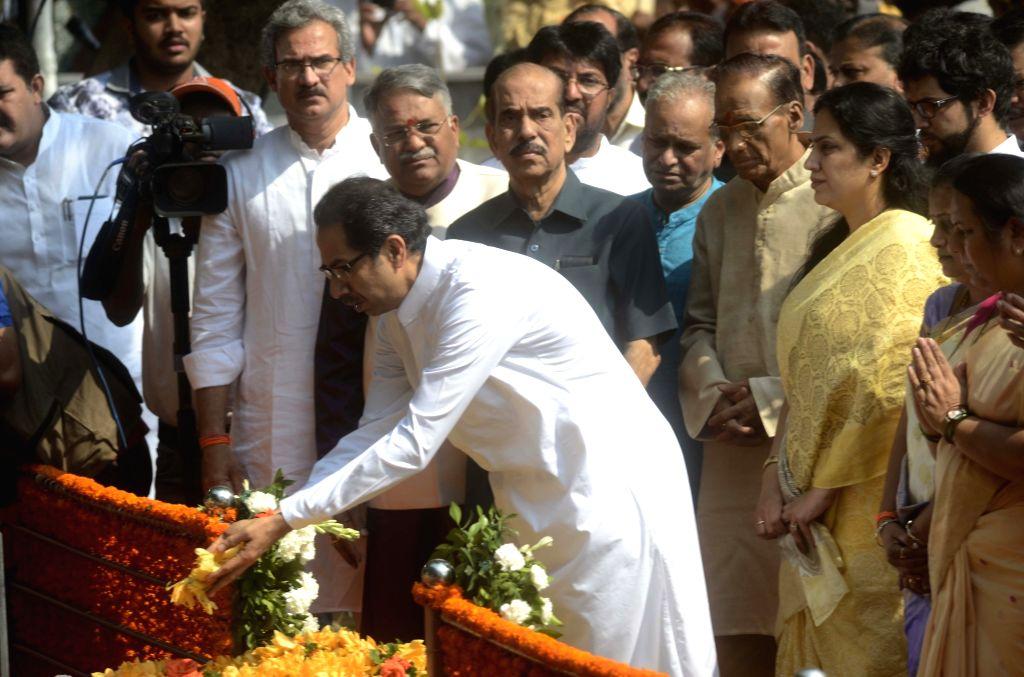 Shiv Sena chief Uddhav Thackeray pays tribute to Shiv Sena founder Balasaheb Thackeray on his death anniversary at Balasaheb Thackeray memorial in Shivaji Park of Mumbai, on Nov. 17, 2015.