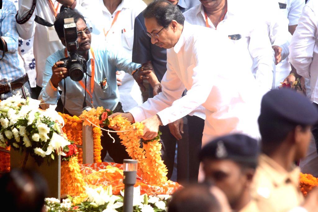 Shiv Sena chief Uddhav Thackeray pays tribute to former Sena supremo Bal Thackeray's on his 7th death anniversary at Shivaji Park Memorial in Mumbai on Nov. 17, 2019.