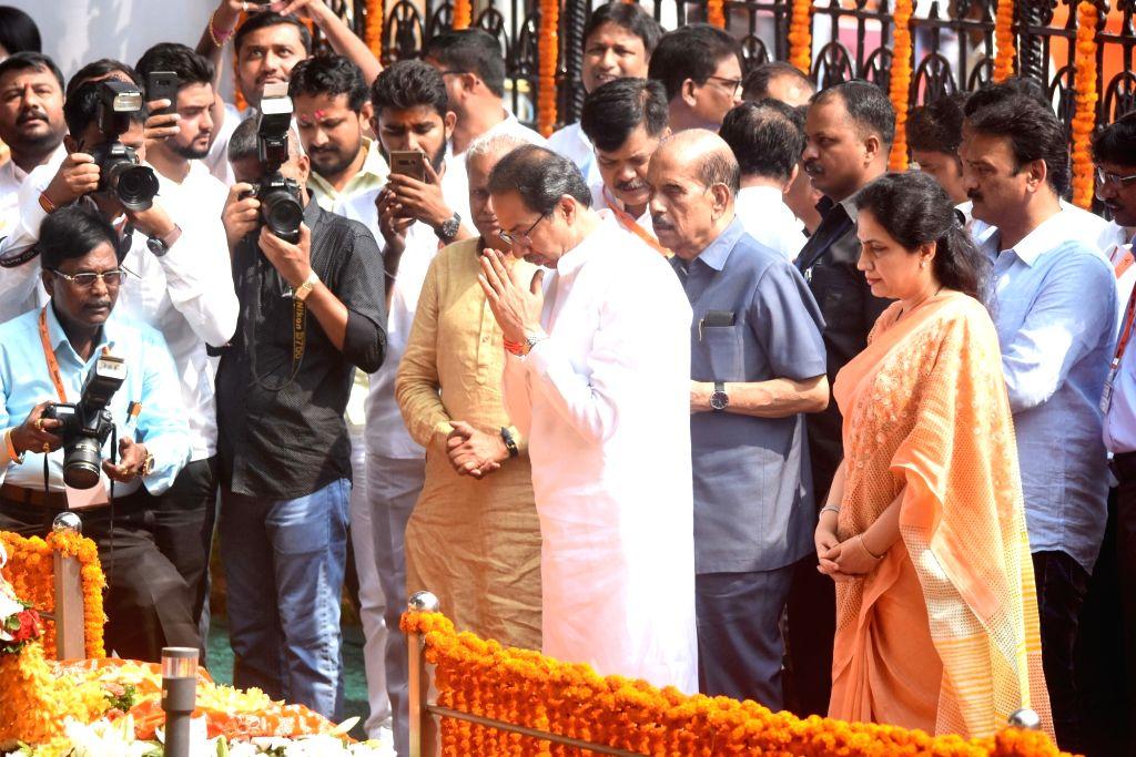 Shiv Sena chief Uddhav Thackeray with his wife Rashmi Thackeray pay tribute to former Sena supremo Bal Thackeray's on his 7th death anniversary at Shivaji Park Memorial in Mumbai on Nov. 17, ...