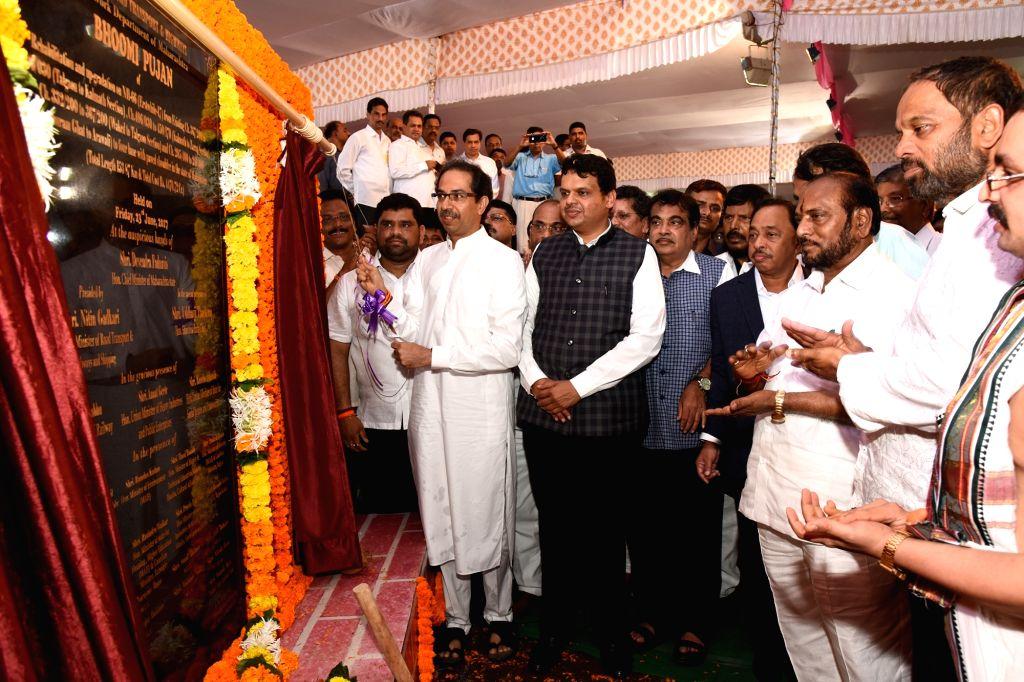 Shiv Sena president Uddhav Thackeray during the inauguration of Mumbai Goa four way highway in Kudal, Sindhudurg district, Maharashtra, on June 23, 2017. Also seen Union Minister Nitin Gadkari ... - Nitin Gadkari