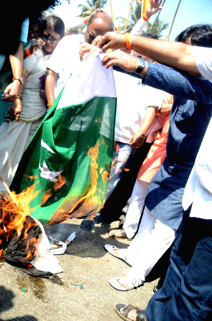 Shiv Sena workers burn Pakistan flag during a protest against suicide attack on a CRPF bus in Jammu and Kashmir's Pulwama district in which atleast 45 soldiers lost their lives; in Mumbai on ...