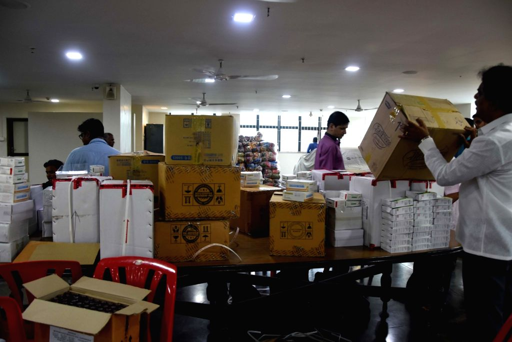 Shiv Sena workers busy assembling relief material at the party's headquarter to be dispatched to Maharashtra's flood affected Kolhapur; in Mumbai on Aug 10, 2019.