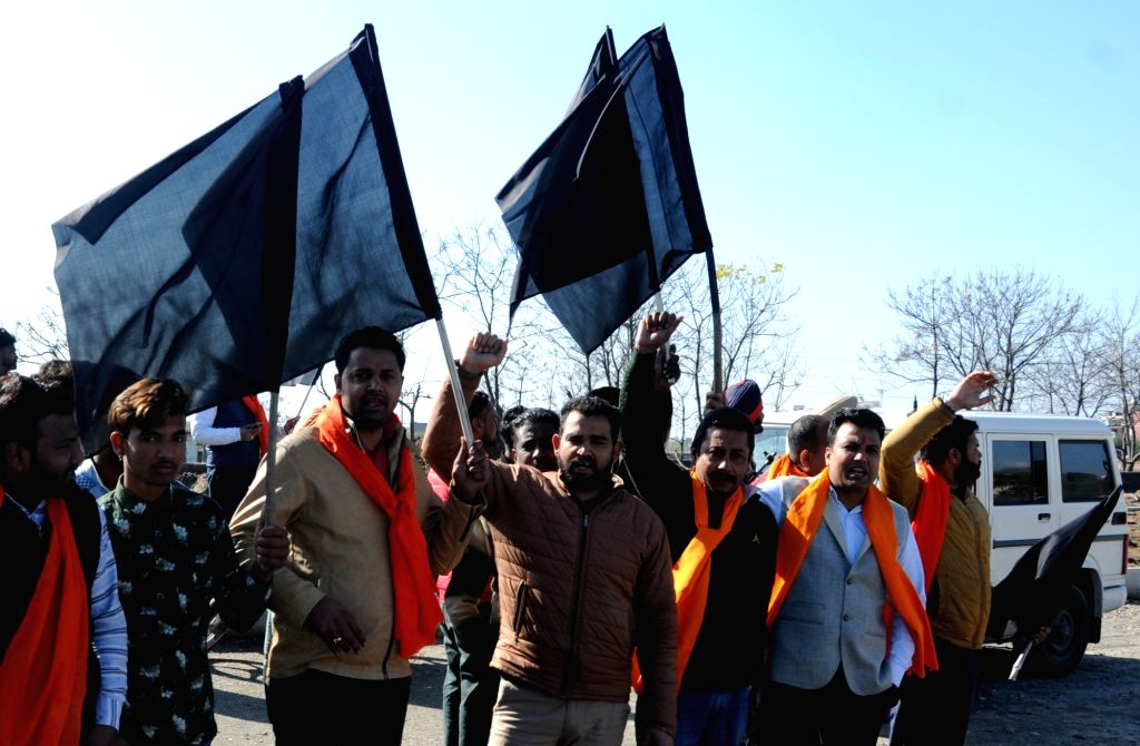 Shiv Sena workers holding black flags, stage a demonstration to demand closure of Indo-Pakistan bus service in the wake of 14 Feb Pulwama militant attack; in Amritsar on Feb 22, 2019.