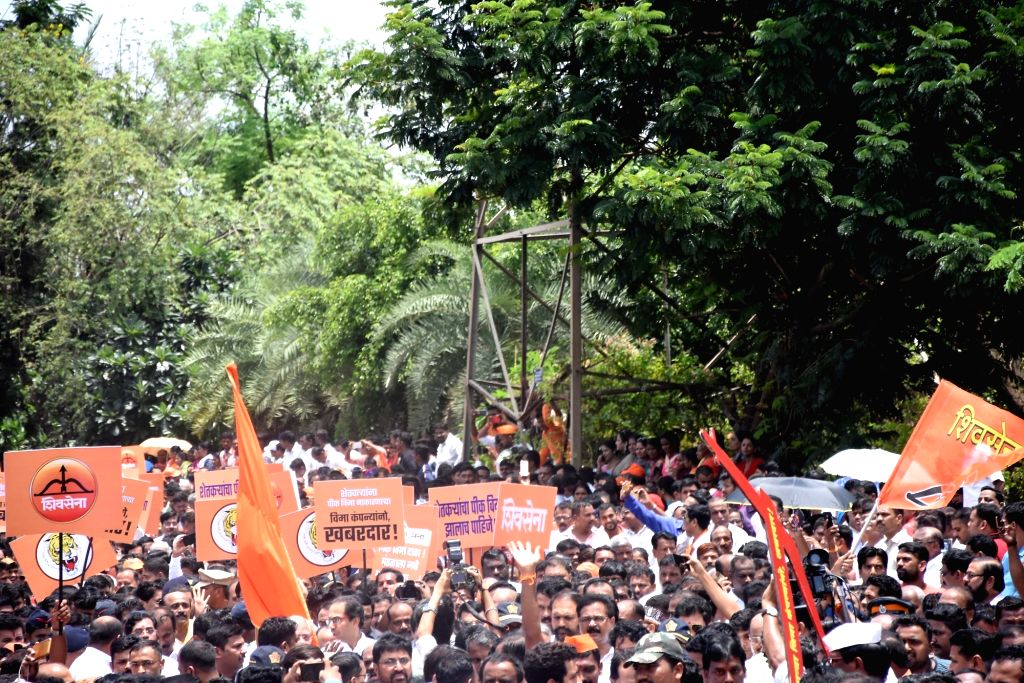 Shiv Sena workers participate in a procession, targeting the high-handed attitude of various private insurance companies in the matter of crop insurance for farmers, in Mumbai on July 17, ...