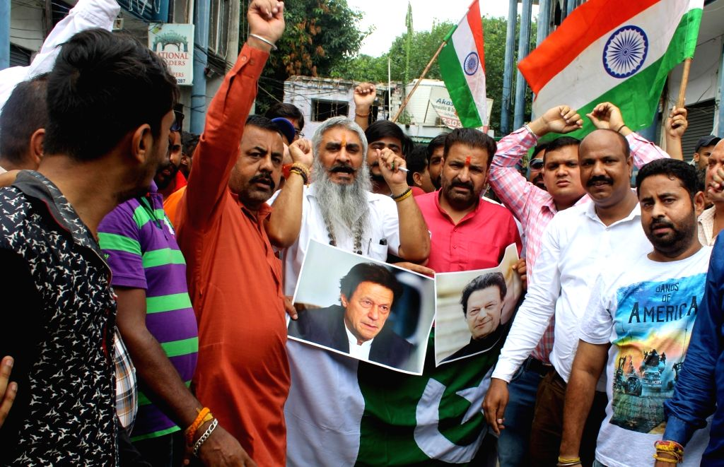 Shiv Sena workers stage a demonstration against Pakistan Prime Minister Imran Khan, in Amritsar on Aug 13, 2019. - Imran Khan