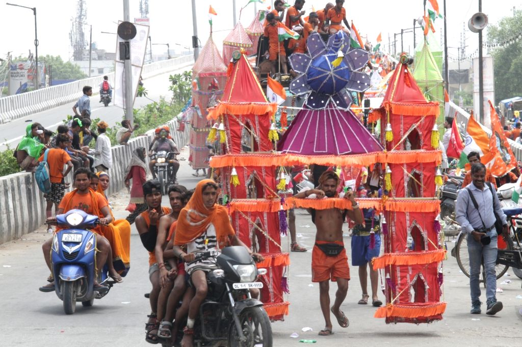 Shiva devotees during the annual Kanwar Yatra, in New Delhi on July 30, 2019. The Kanwar Yatra 2019 began on July 17. During this yatra, devotees collect sacred waters of the Ganga river ...