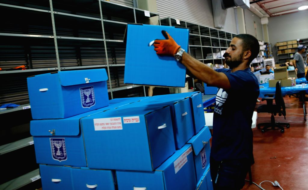 SHOHAM (ISRAEL), Sept. 2, 2019 A worker prepares materials for Israeli elections at the Israeli Central Elections Committee Logistics Center in Shoham, Israel, on Sept. 2, 2019. Israel ...