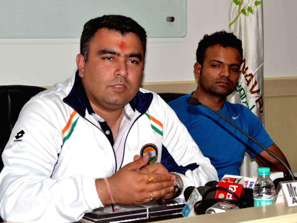 Shooters Vijay Kumar and Gagan Narang during a press conference in Faridabad on August 1, 2014. - Vijay Kumar