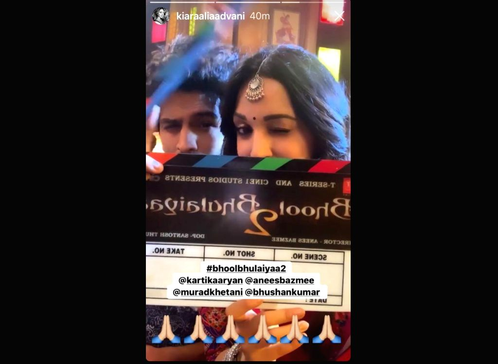 "Shooting for the second instalment of ""Bhool Bhulaiyaa"" directed by Anees Bazmee has begun. Actress Kiara Advani took to her Instagram Stories, where she shared a boomerang video of herself along with actor Kartik Aaryan and the film's clapboard. (Ph - Kiara Advani"