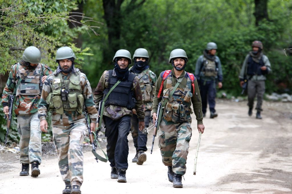 Shopian: Security forces during a cordon and search operation after a militant was killed in a gunfight with the security forces in Jammu and Kashmir's Shopian district, on May 3, 2019. (Photo: IANS)