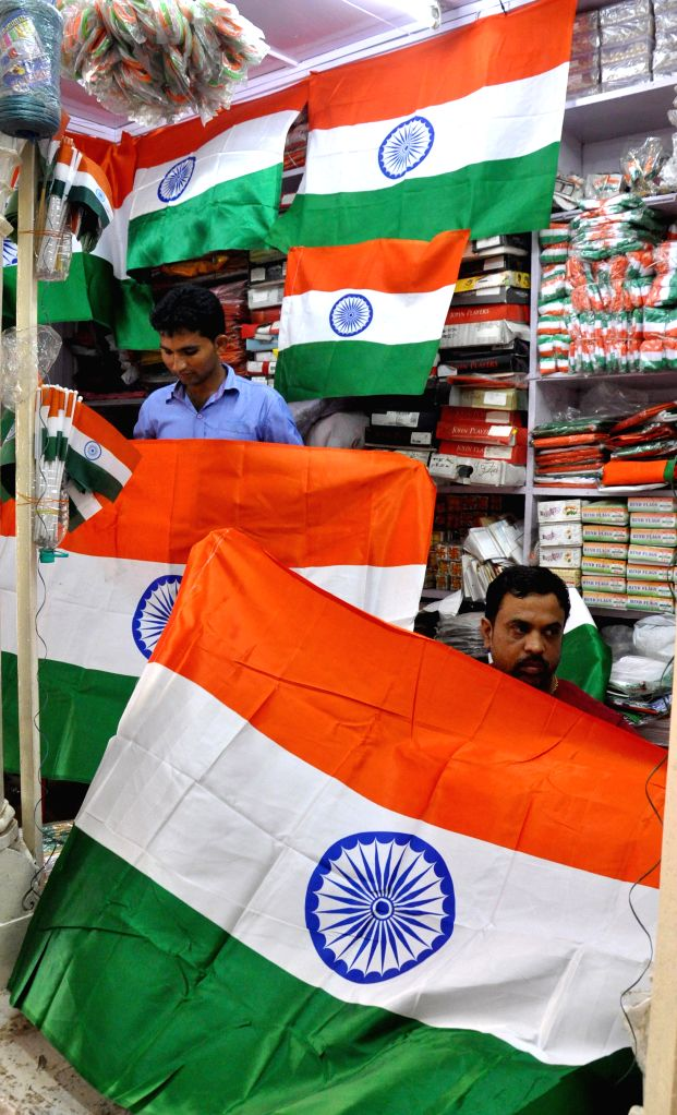 Shopkeepers display Indian flags at their shop ahead of Independence Day in Jaipur on Aug 11, 2014.