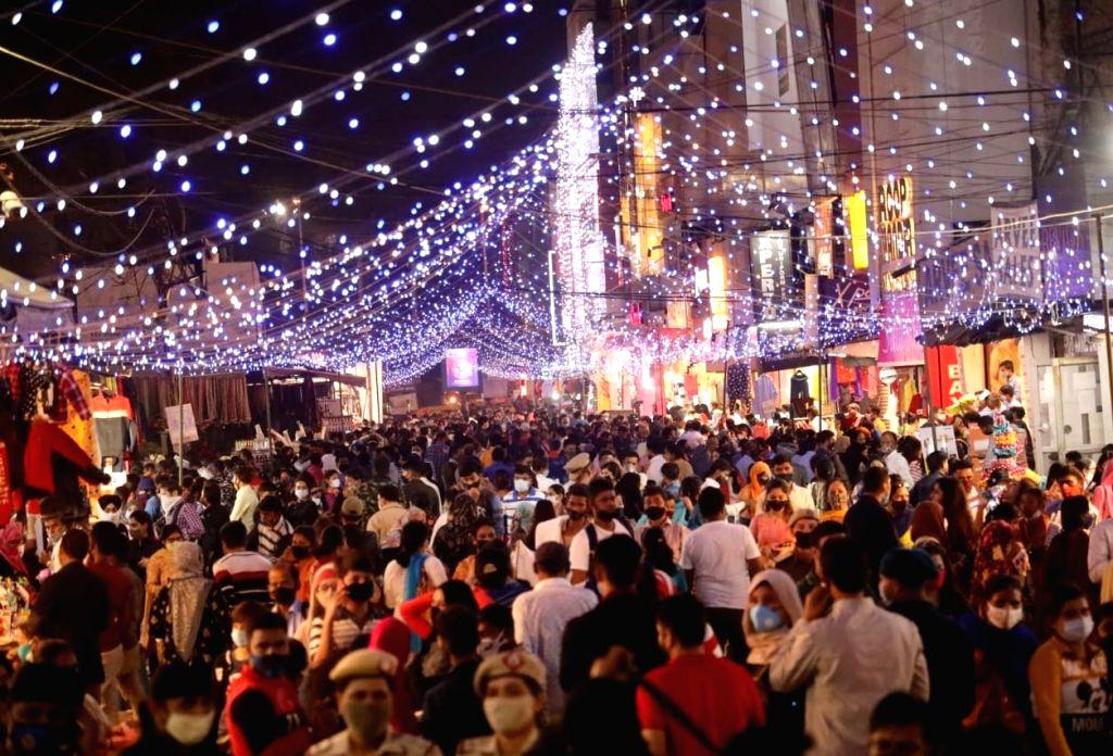 Shoppers throng Lajpat Nagar market on the eve of Diwali, in New Delhi on Nov 13, 2020.