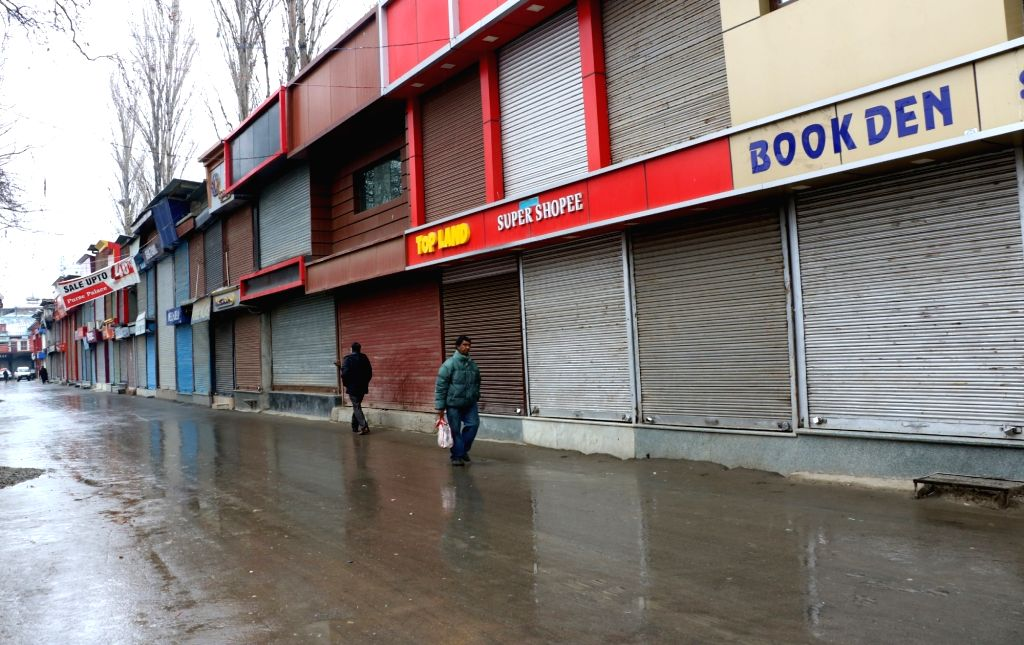 Shops remain closed in Srinagar during a shutdown observed to mourn the killing of two militants in an encounter at Padgampora Village in Awantipora of Jammu and Kashmir's Pulwama district; ...