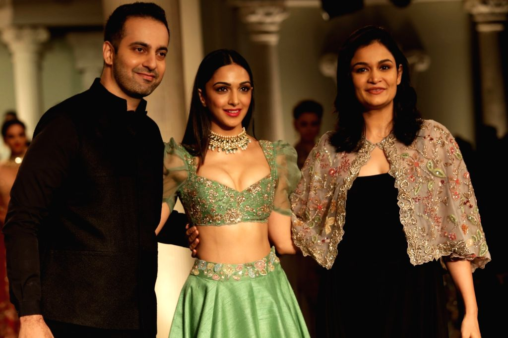 Showstopper Kiara Advani with designers Shyamal and Bhumika walks down the ramp, at India Couture Week 2018, in New Delhi, on July 29, 2018. - Kiara Advani