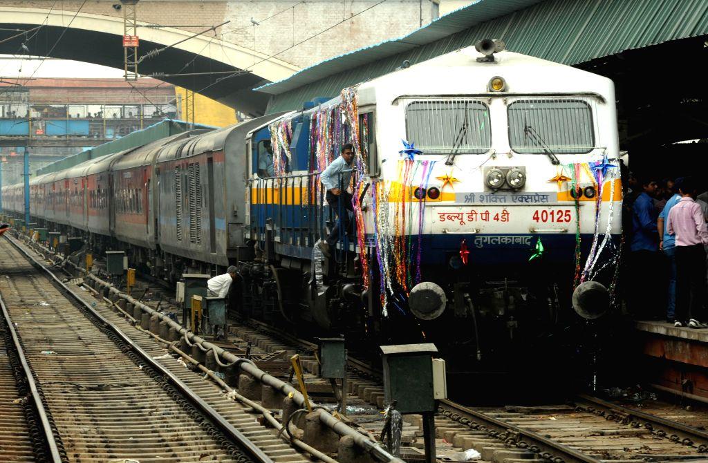 Shri Shakti Express chugs out of New Delhi railway station with devotees headed to Mata Vaishno Devi Shrine on July 14, 2014. The train will reach Mata Vaishno Devi railway station (Katra) at 5.10 am