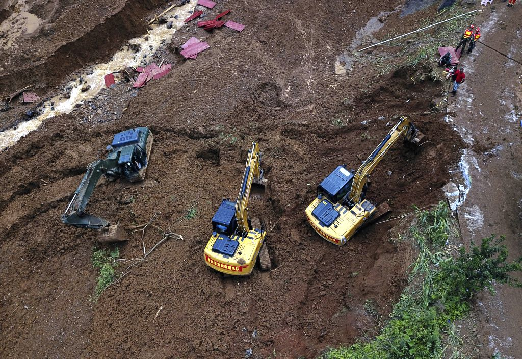 SHUICHENG, July 25, 2019 - Aerial photo taken on July 25, 2019 shows rescuers working at the landslide site in Shuicheng County of Liupanshui City, southwest China's Guizhou Province. The death toll ...