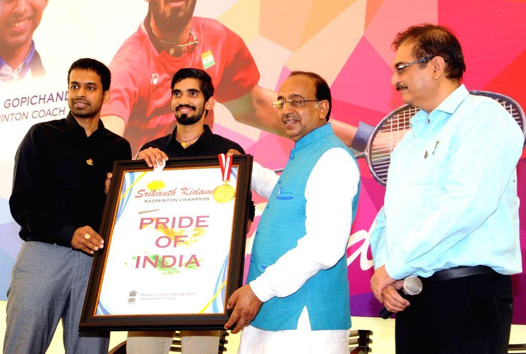 Shuttler Kidambi Srikanth and chief national coach Pullela Gopichand call on Union Sports Minister Vijay Goel in New Delhi on July 1, 2017. - Vijay Goel