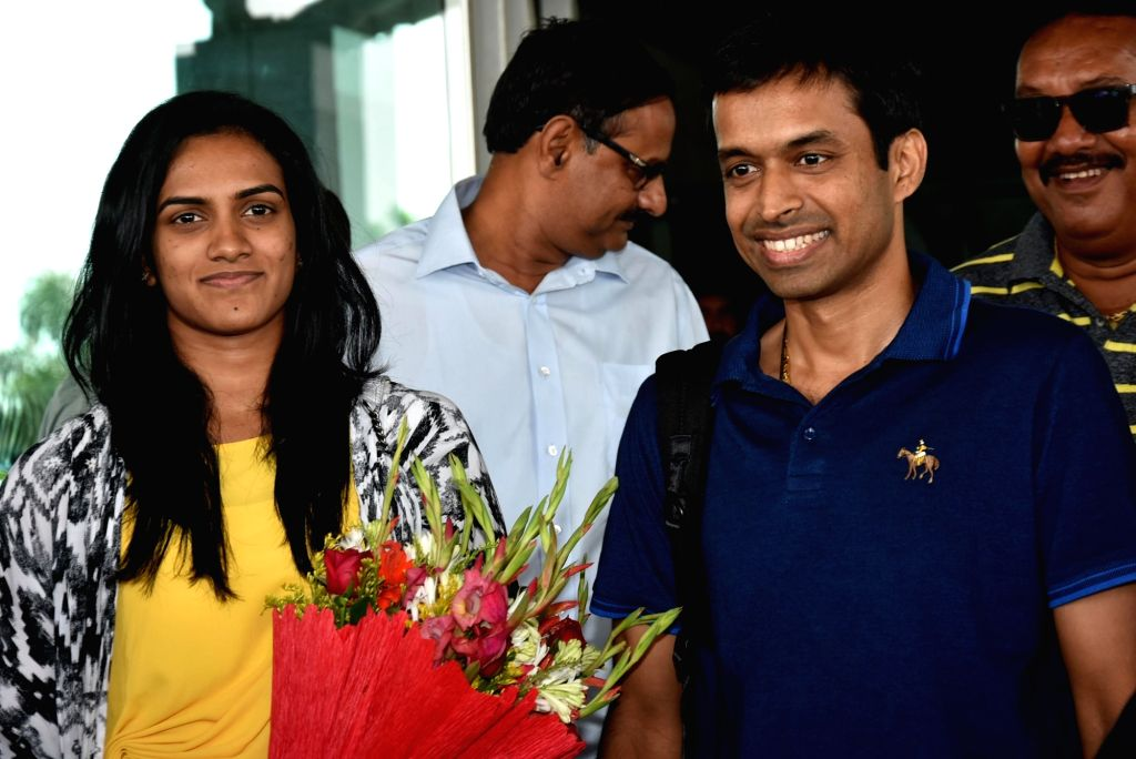 Shuttler P. V. Sindhu and India's chief badminton coach P. Gopichand on their arrival at the Birsa Munda International Airport in Ranchi on May 20, 2018.
