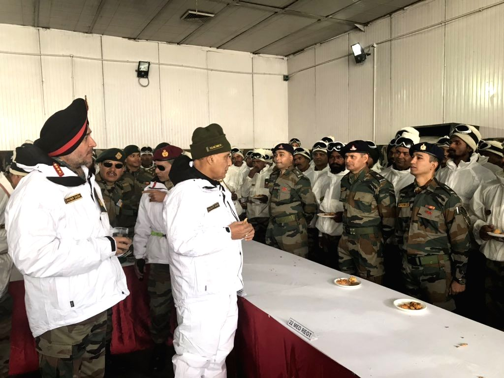 Siachen: Defence Minister Rajnath Singh interacts with the troops during his visit to the Siachen Army Base Camp in Jammu and Kashmir, on June 3, 2019. (Photo: IANS) - Rajnath Singh