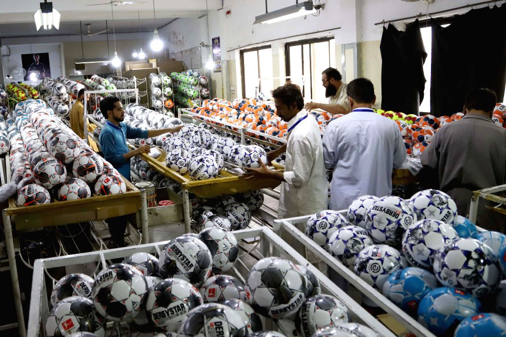 SIALKOT, May 1, 2019 - Photo taken on April 12, 2019 shows workers checking newly-made footballs at a football factory in eastern Pakistan's Sialkot. Sialkot, a city in Pakistan's Punjab province, is ...