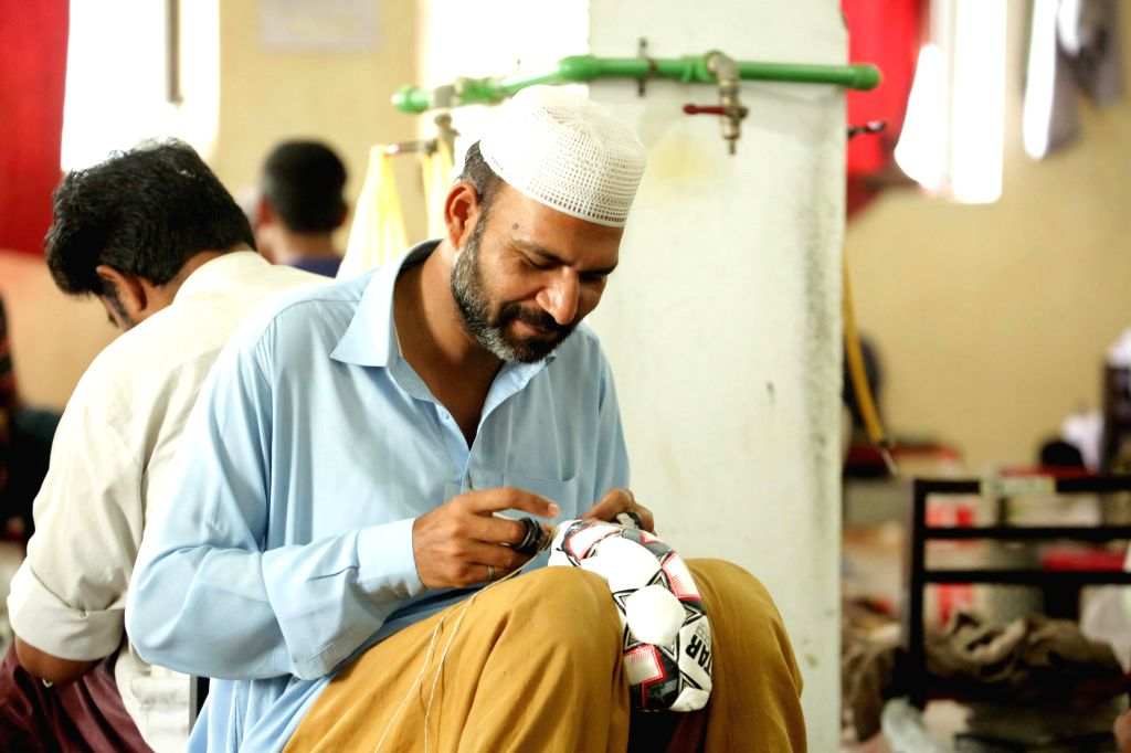 SIALKOT, May 1, 2019 - Photo taken on April 12, 2019 shows a worker stitching a football at a football factory in eastern Pakistan's Sialkot. Sialkot, a city in Pakistan's Punjab province, is a ...