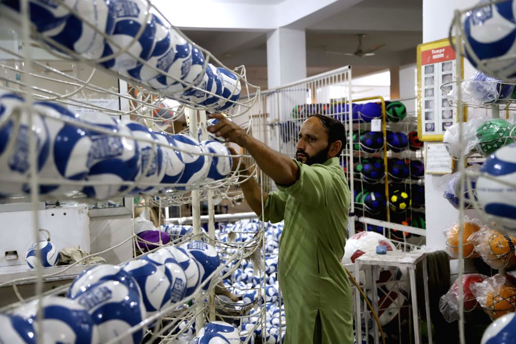 SIALKOT, May 1, 2019 - Photo taken on April 12, 2019 shows a worker arranging newly-made footballs at a football factory in eastern Pakistan's Sialkot. Sialkot, a city in Pakistan's Punjab province, ...