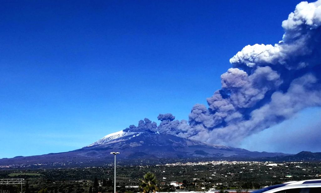 SICILY (ITALY), Dec. 24, 2018 Photo taken on Dec. 24, 2018 shows the Mount Etna volcano during the eruption in Catania, Sicily, Italy. Sicily's Mount Etna volcano erupted on Monday, the ...