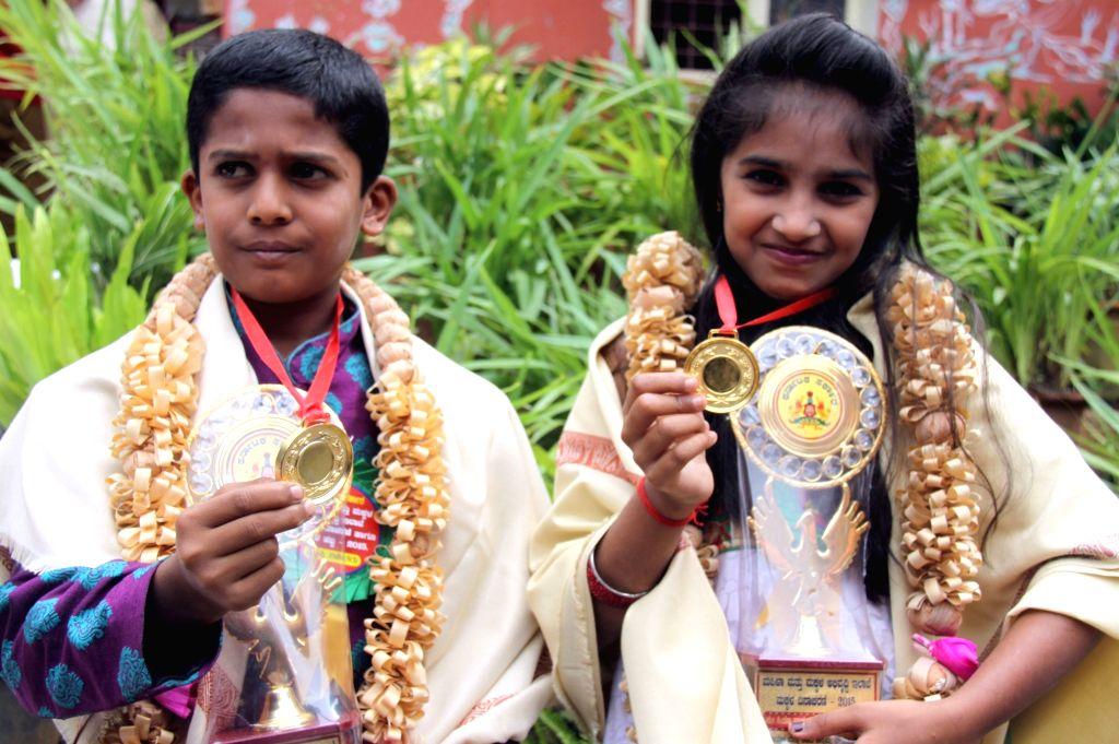 Siddesh and Siya Vamanasa Khode, who were presented bravery awards during a Karnataka government's Children's Day celebration program at Balbhavan in Bengaluru on Nov 14, 2015.