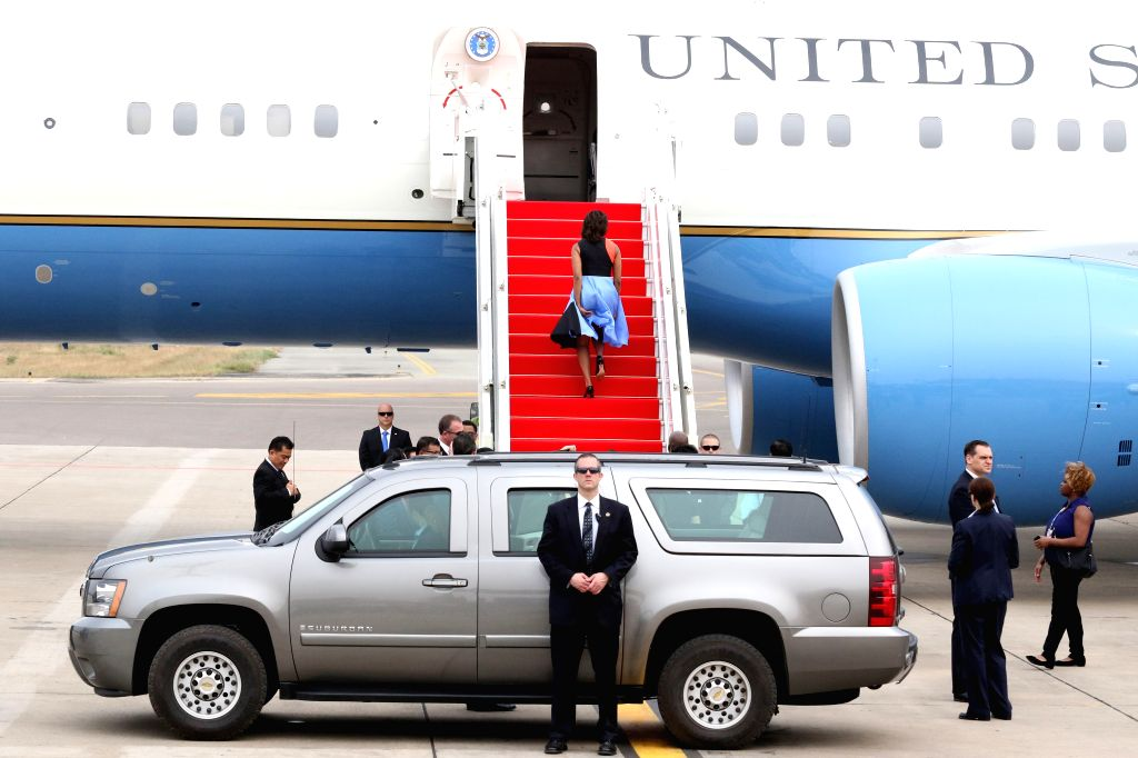 U.S. first lady Michelle Obama walks onto the plane in Siem Reap, Cambodia, March 22, 2015. U.S. first lady Michelle Obama left here on Sunday for the United ...