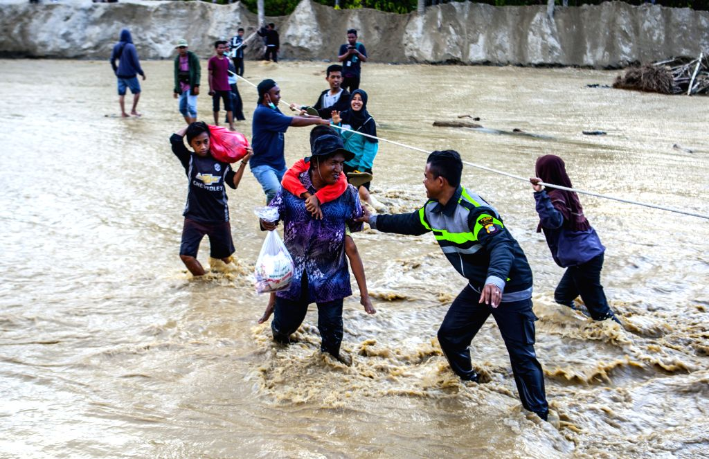 SIGI, May 1, 2019 - People cross a river after flood at Bangga village in Sigi, Central Sulawesi, Indonesia. May 1, 2019. Heavy rainfall in Sigi regency, Central Sulawesi, has caused a flash flood ...