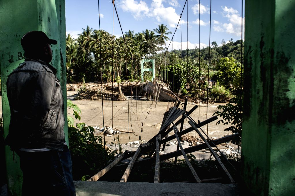 SIGI, May 4, 2019 - A man looks at a damaged bridge after a flood hit Tuva village in Sigi Regency, Central Sulawesi, Indonesia, May 4, 2019. Heavy rainfall in Sigi Regency, Central Sulawesi has ...