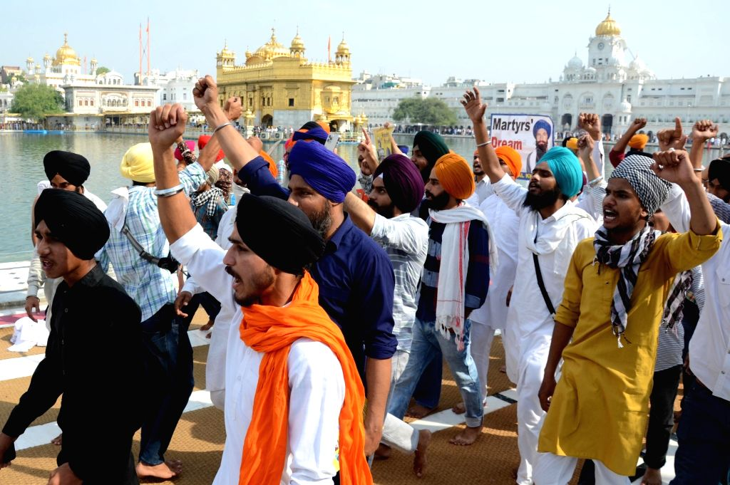 Sikh activists from radical Sikh organisations shout slogans in support of Sikh leader Sant Jarnail Singh Bhindranwale and Khalistan, the name for an envisioned independent Sikh state, ...