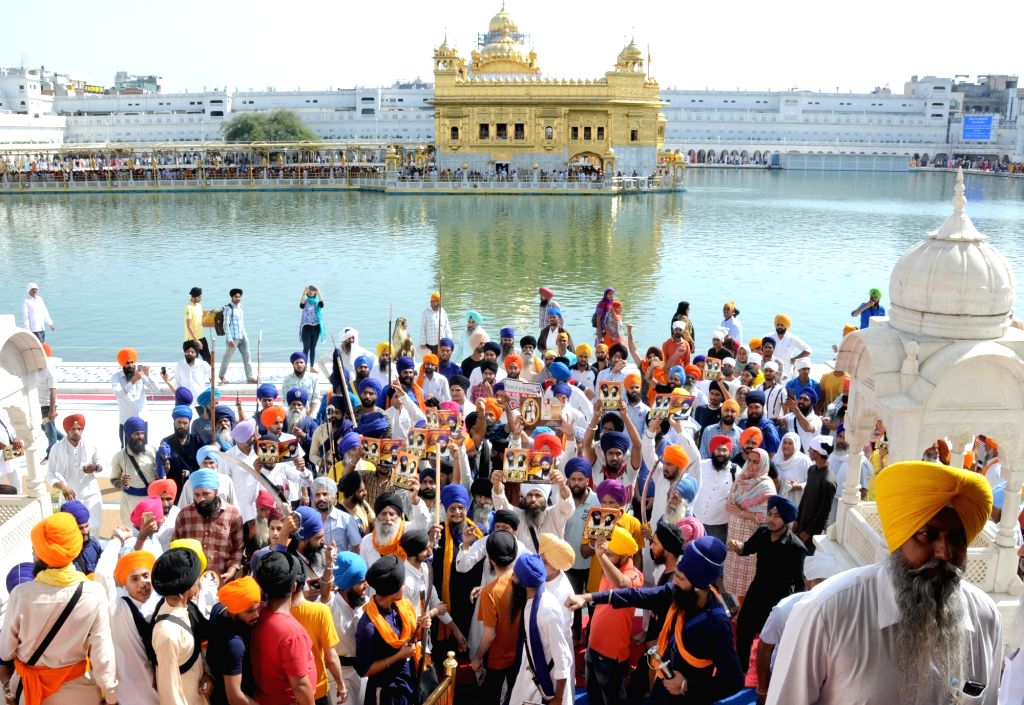 Sikh activists participate in a ???genocide remembrance march??? organised by the Shiromani Gurdwara Parbandhak Committee on the 35th anniversary of Operation Bluestar, at the Golden Temple in ...