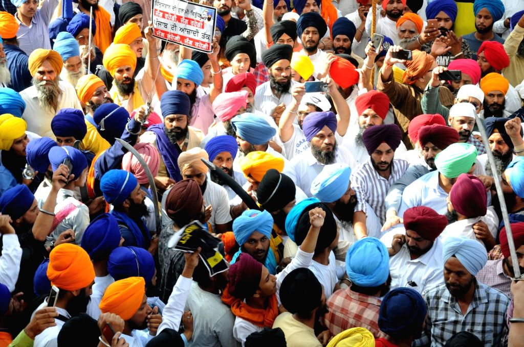Sikh activists participate in a ???genocide remembrance march??? organised by the Shiromani Gurdwara Parbandhak Committee on the 35th anniversary of Operation Bluestar, at the Golden Temple ...