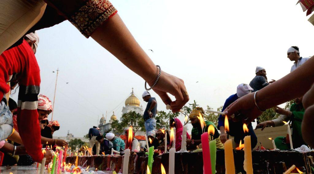 Sikh devotees at the Bangla Shahib Gurdwara on the birth anniversary of First Guru Of Sikhs Guru Nanak Dev in New Delhi on Nov 14, 2016. - Guru Nanak Dev