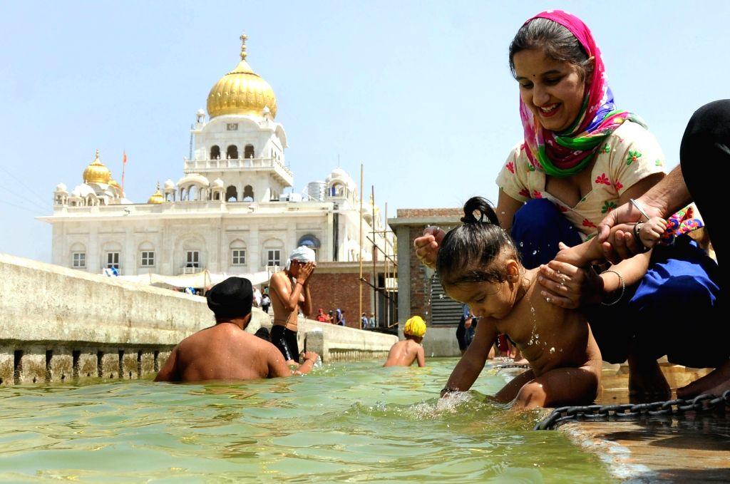 Sikh devotees celebrate Baisakhi at Gurudwara Bangla Sahib in New Delhi on April 13, 2016.