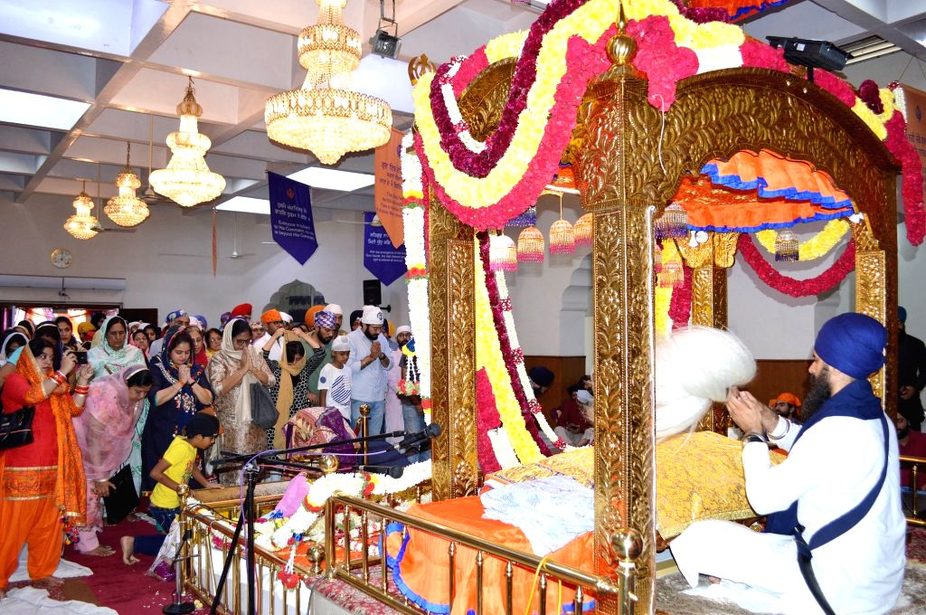 Sikh devotees during the 550th birth anniversary celebrations of Guru Nanak Dev at Gurunanak Bhavan in Bengaluru on Nov 12, 2019. - Nanak Dev