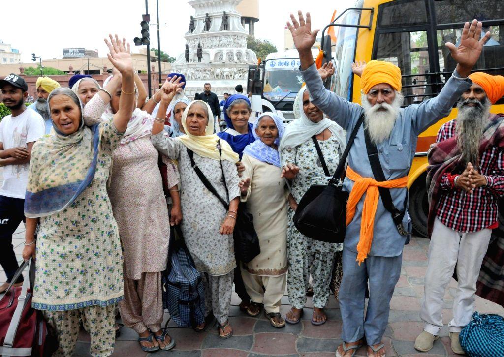 Sikh devotees leave for Pakistan to celebrate Baisakhi, from Amritsar on April 12, 2019.